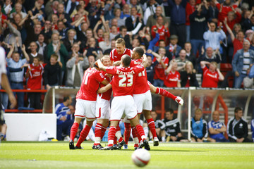 Radoslaw Majewski (hidden) celebrate scoring the first goal for Nottingham Forest with team mates