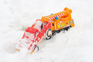 Play toys with a car in the snow