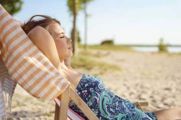 Young woman spending a relaxing day at the beach