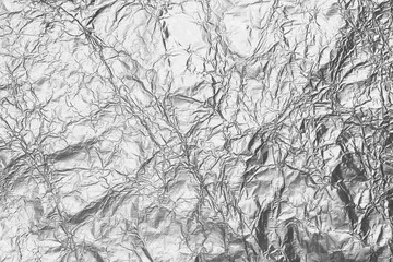 Shiny silver gray foil texture for background and design art work.