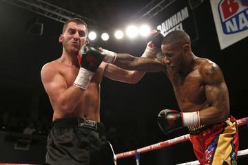 Andrew Robinson (R) in action against Christian Hoskin-Gomez
