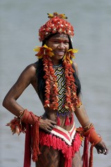 An indigenous woman from Karaja tribe poses for photos after participating in a parade of indigenous beauty during the first World Games for Indigenous Peoples in Palmas