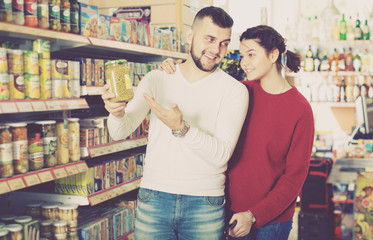 Customers buying tinned food at canned section