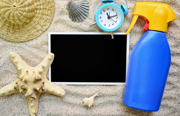 Photo with black background and beach accessories in the sand