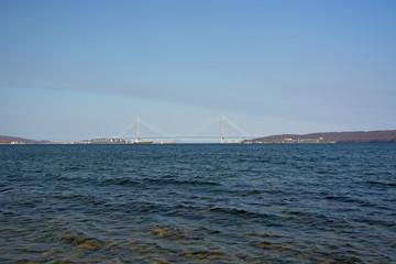 port city high bridge across the Bay, the coastline, waves and blue sky