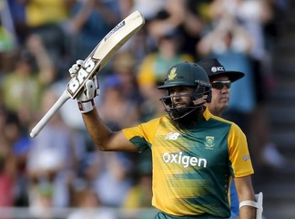 South Africa's Hashim Amla raises his bat to celebrate his fifty during their second T20  international cricket match against England