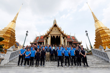 Leicester City soccer team poses for a while as they visit the Emerald Buddha temple in Bangkok