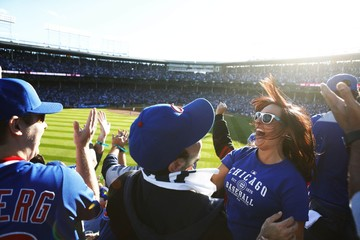File photo of Chicago Cubs fans celebrate after Chicago Cubs Baez hit a three run home run during the second inning of game four of the NLDS against the St. Louis Cardinals at Wrigley Field in Chicago
