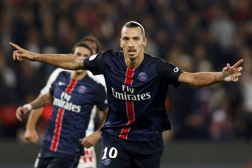 Paris St Germain's Ibrahimovic reacts after scoring against Olympique Marseille during his French Ligue 1 soccer match at the Parc des Princes stadium in Paris