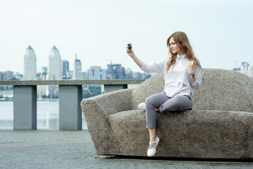 trendy young woman taking a selfie in the city10