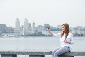 trendy young woman taking a selfie in the city11