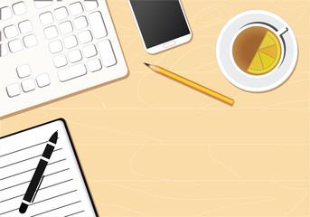 Desktop, computer, keyboard, notebook, phone, pen and tea cup on wooden desk.