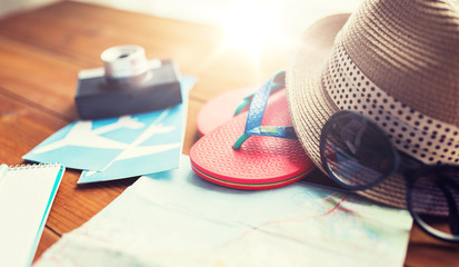close up of travel map, flip-flops, hat and ticket