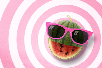 Watermelon wearing sunglasses on circle pattern pink and white background with copy space.,Pastel tone.