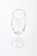 Empty clear champagne glass isolated. Wine glass on white background.