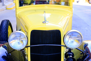 A 1930s yellow pickup truck outside Pack's Tavern on Spruce Street in downtown Asheville NC