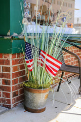 Patriotic bucket of bullrushes outside a store in Beaufort, SC