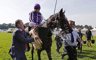 Ryan Moore celebrates after winning the 4.20 Prince Of Wales' Stakes on Highland Reel