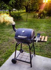 Garden smoker BBQ puffing out smoke