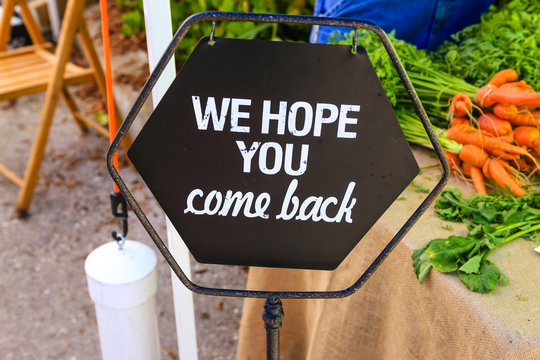 We hope you come back sign seen at a farmers market