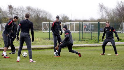 (From left to right) Manchester United's Rio Ferdinand, Michael Carrick, Robin van Persie, Wayne Rooney and Alexander Buttner during training