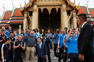 Leicester City soccer team members pose for a while as they visit the Emerald Buddha temple in Bangkok