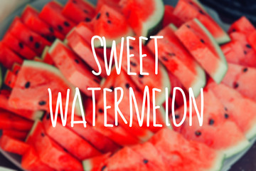 Slices of fresh ripe red watermelons blur background.