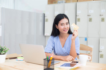 Young asian woman holding cradit card for  buy online store, woman online shoping concept.