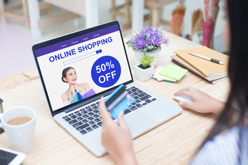 Woman holding cradit card for shopping online at website, Close up to mornitor laptop, woman shopping concept.