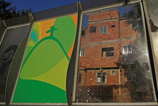 A banner advertising the 2016 Rio Olympics is seen near the Mare slums complex of the Linha Vermelha freeway connecting Rio de Janeiro's International Airport with Rio de Janeiro's downtown and south zone