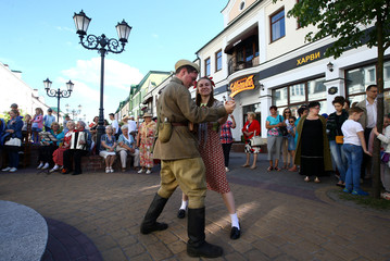Military enthusiasts dressed as Soviet Red Army soldier and civilian woman from the World War Two period dance as they mark the 76th anniversary of the Nazi Germany invasion, in Brest