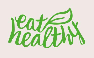 Handwritten Eat Healthy label with leaf