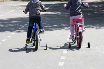 Girl and boy riding bicycles.