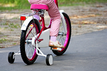 Girl riding her bike.