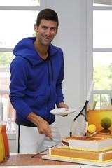 Tennis - French Open - Roland Garros - Paris, France - 22/05/16. Novak Djokovic of Serbia cuts his birthday cake