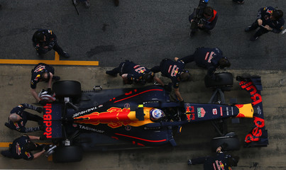 Red Bull Formula One driver Ricciardo of Australia makes a pit stop during the second testing session ahead the upcoming season at the Circuit Barcelona-Catalunya in Montmelo