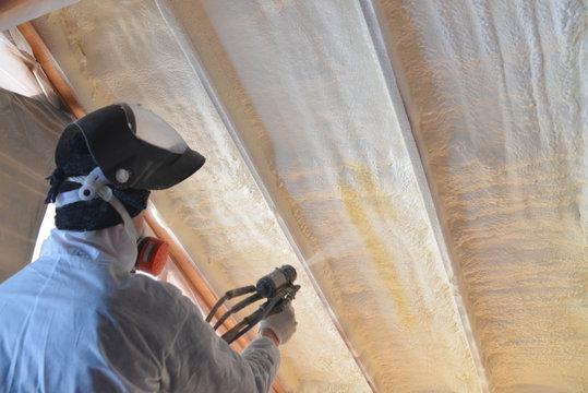 Polyurea Spraying, warming foam coating of roof, focus on wall