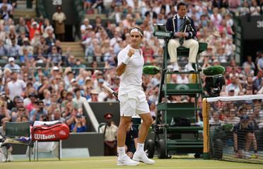 Men's Singles - Switzerland's Roger Federer celebrates winning his quarter final match