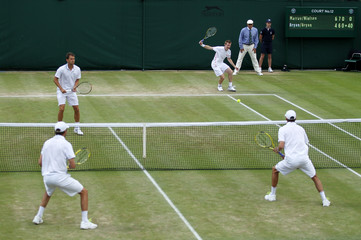 Men's Doubles - Great Britain's Jonathan Marray and Denmark's Frederik Nielsen in action against USA's Bob Bryan and Mike Bryan