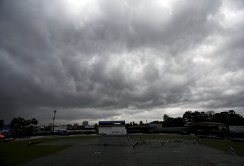 Dark clouds gather overhead as the match was stopped due to rain on the third day of the second test cricket match between Sri Lanka and West Indies in Colombo
