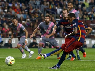 Barcelona's Neymar shoots a penalty to score a goal against Rayo Vallecano during their Spanish first division soccer match at Camp Nou stadium in Barcelona