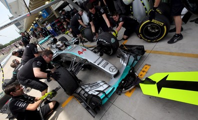 Mechanics of Mercedes Formula One practice a pit stop on the  car of Hamilton of Britain during the third free practice of the Brazilian F1 Grand Prix in Sao Paulo