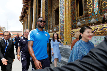 Leicester City soccer club's captain Wes Morgan walks while visits the Emerald Buddha temple in Bangkok