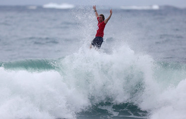Florence of Hawaii gestures after winning the World Surf League's Rio Pro championship men's final at Barra da Tijuca beach in Rio de Janeiro