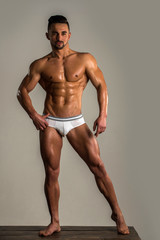 Man in sexy white lingerie. Naked torso. Athlete young handsome. Personal fitness trainer. Power athletic man pumping muscles. Bodybuilder fitness model underwear sexy. Sexy portrait very muscular