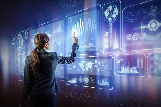 futuristic interface. woman engineer touching virtual screens.