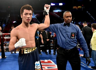 Boxers Ryota Murata of Japan looks on with his hand raised by Referee Kenny Bayless  after defeating  Gunnar Jackson of New Zealand by an unanimous decision in a middleweight bout at the Thomas & Mack Center in Las Vegas