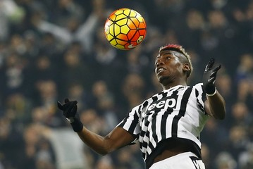 File photo of Juventus' Paul Pogba jumping for the ball.