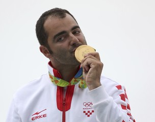 2016 Rio Olympics - Shooting - Victory Ceremony - Men's Trap Victory Ceremony