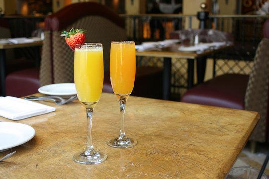 Two mimosa cocktail glasses, lifestyle, horizontal